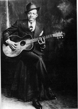 Robert Johnson, hat and guitar
